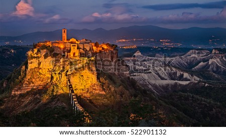 Civita di Bagnoregio, Viterbo, Lazio, Italy: picturesque landscape at twilight of the ancient village on the steep tuff hill