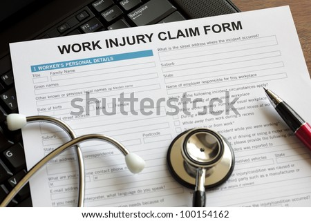 Claim form for an injury at work - stock photo