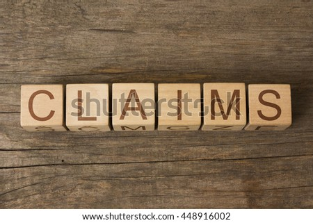 CLAIMS word in vintage wooden blocks