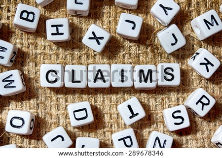 CLAIMS word on white blocks concept - stock photo