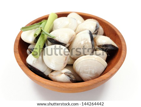 clam and lemon grass on wooden bowl - stock photo