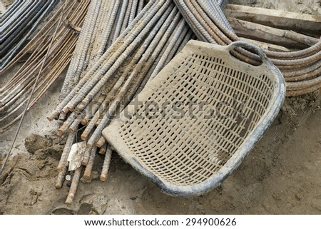 clam-shell shaped basket at construction site - stock photo