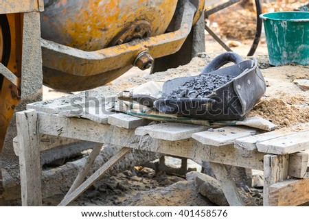 clam-shell shaped basket stone waiting to be mixed with concrete and milling machines. - stock photo