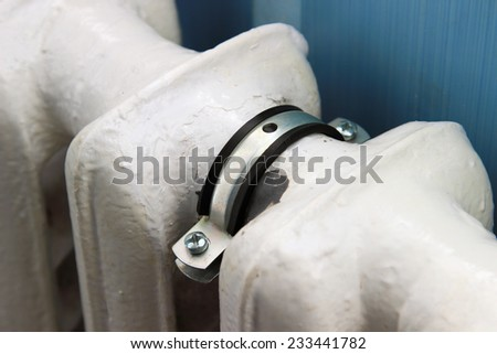 Clamp on the old radiator - stock photo