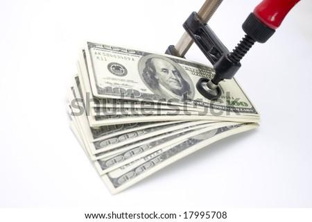 Clamp squeezing money - stock photo