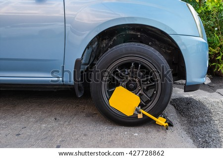 clamped front wheel of illegally parked car