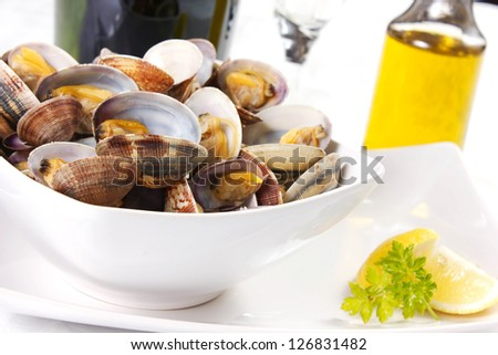 clams  cooked in a dish with lemon and parsley - stock photo