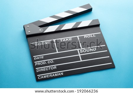 clapperboard on light blue background - stock photo