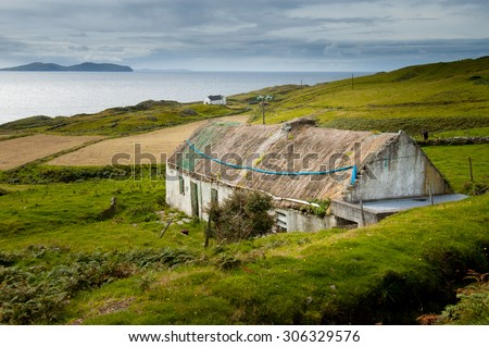 Clare Island, Ireland. August 28, 2004. Abandoned cottage with thatched roof - stock photo