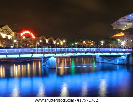 Clarke Quay in downtown Singapore at night - stock photo