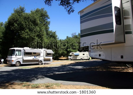 Class A Motorhome RV Camping at a Resort Campground - stock photo