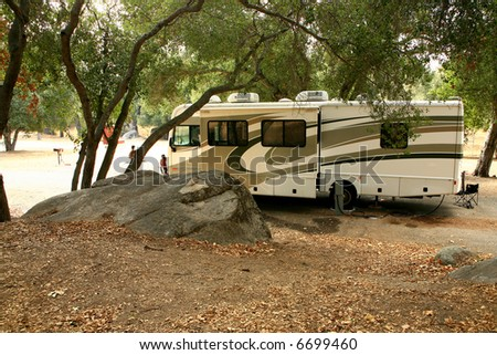 Class A RV Coach Parked in a Rural Campsite - stock photo