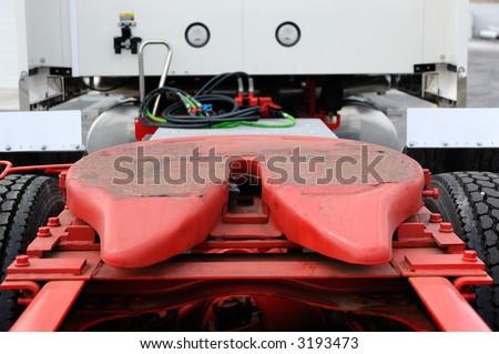 Class eight semi truck trailer hitch. - stock photo