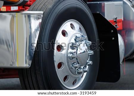 Class eight semi truck wheel. - stock photo