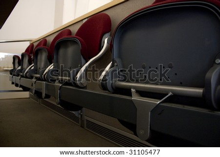Class room with stairs, desks and seats