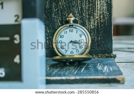 Classic antique wooden clock on a black background. - stock photo
