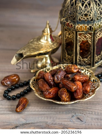 Classic arabic lamps, dates and rosary. Islamic holidays concept - stock photo