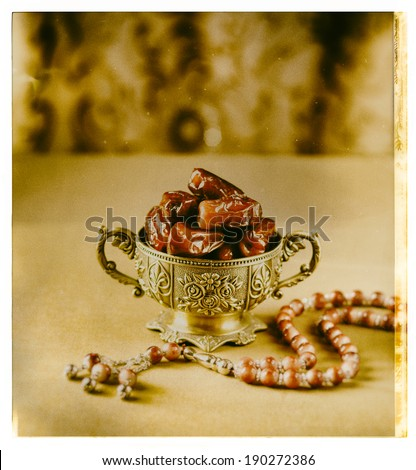 Classic arabic teacups and dates. - grunge photograph effect - stock photo
