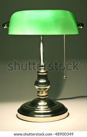 Classic banker desk lamp on table with cable