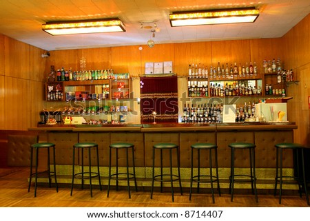 classic bar counter interior with empty seats - stock photo