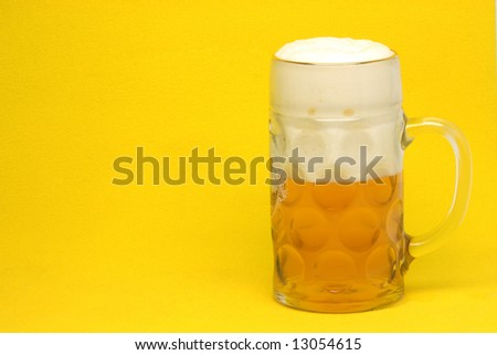 classic bavarian beer mug in yellow background with copy space