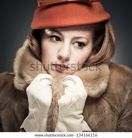 Classic Beauty Clutching Her Faux Fur - stock photo