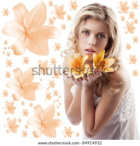 classic beauty portrait of young and beautiful woman with orange lily and blond curly hair on white background - stock photo