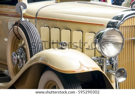 classic beige car details close up lights and whitewall tyre
