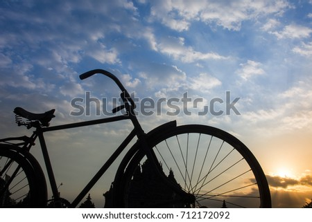 classic bicycle silhouette with sunset background