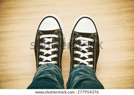 Classic black and white sneakers top view - stock photo