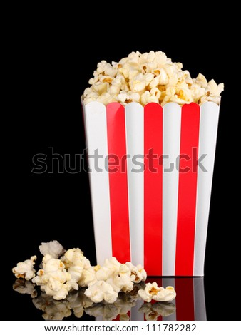 classic box of popcorn isolated on black - stock photo