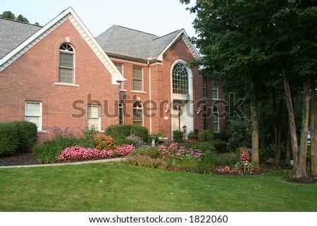 classic brick home - stock photo