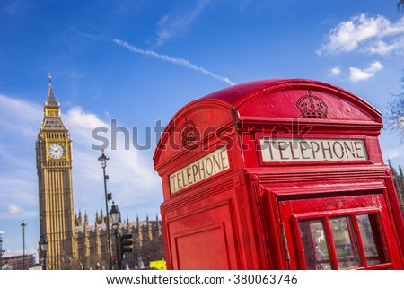 Classic British red telephone box with Big Ben on a sunny day with blue sky - London, UK - stock photo