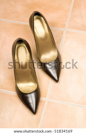 Classic brown shoes on the floor. - stock photo