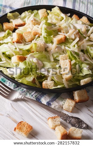 Classic Caesar Salad close-up on a plate. vertical  - stock photo