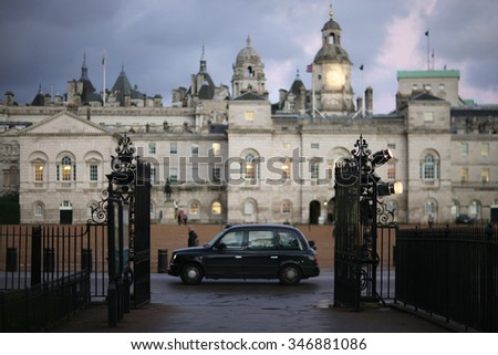 Classic car driving along street in London, Horse Guards - stock photo
