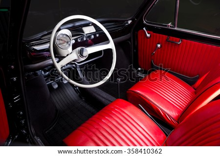 Classic car interior - red leather - stock photo