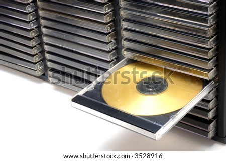 Classic CD/DVD case with golden disc - stock photo
