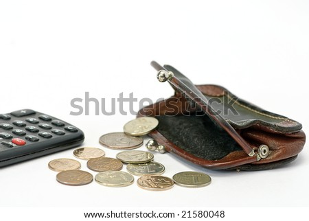 classic change purse on white and calculator