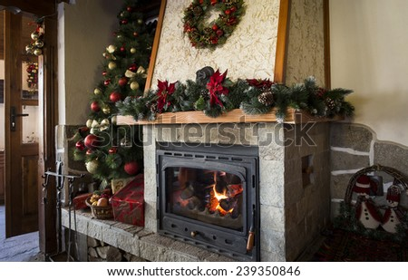 Classic christmas decorated fireplace and christmas tree - stock photo