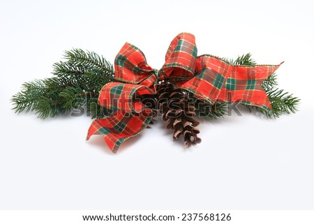 Classic Christmas decoration of pine branches and ribbon isolated on white background - stock photo