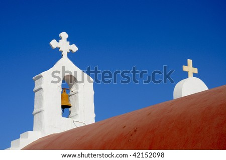 Classic church in Greece with with, blue and red contrast - stock photo