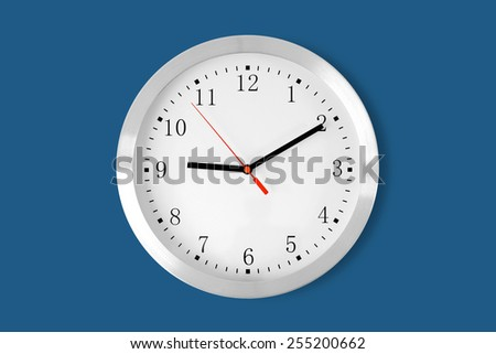 classic clock on blue background - stock photo