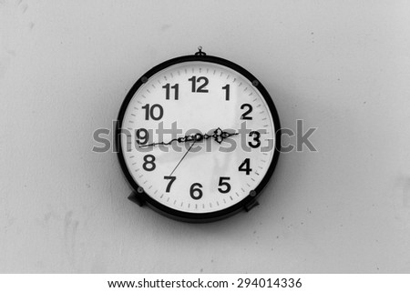 Classic Clock on dirty walls with Black and White.  - stock photo