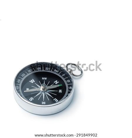 Classic compass isolated, shallow DOF, focus on dial - stock photo