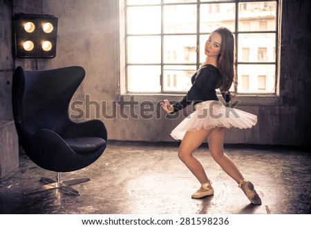 classic dancer in action. woman performing dancing moves on the dance floor. concept about dancing, sport and people - stock photo