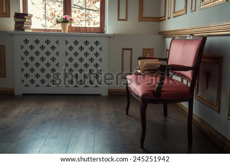 Classic design wall with moldings. Fragment of elegant vintage interior with white wall and golden moldings, studio shot - stock photo