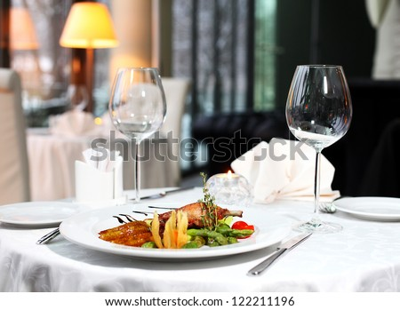 classic dinner setting in the restaurant - stock photo
