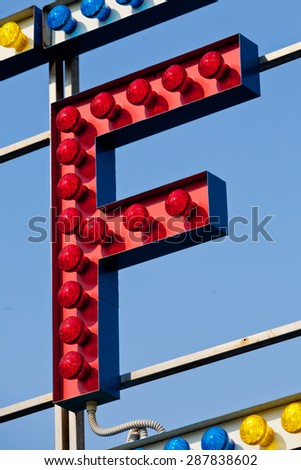 classic electric sign like the ones used in circus or old fashioned shops representing the F letter - stock photo
