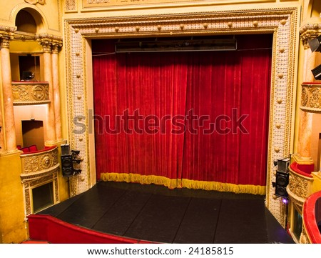 classic elegant theater stage with velvet curtains from balcony - stock photo